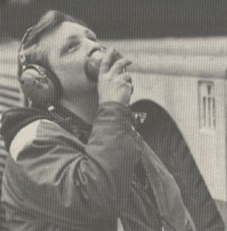 1981 A mechanic on pushback headset speaking to the pilots in the cockpit