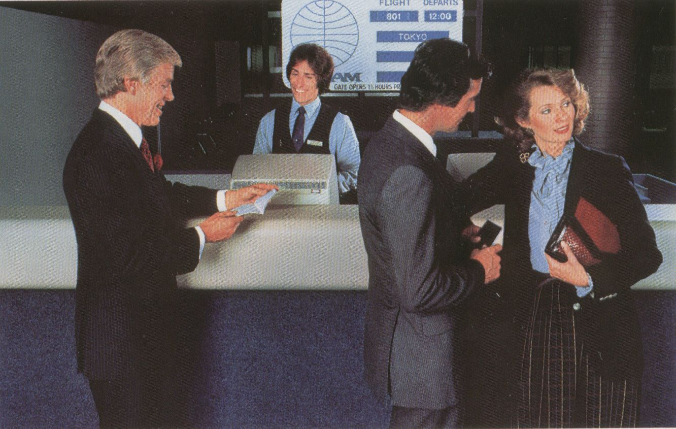 1981 A Passenger Service Agent assists customers at a departure gate counter at New York JFK Airport.