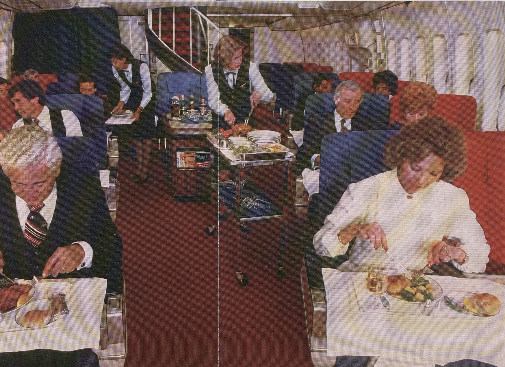 1983 A Boeing 747 First Class cabin during an elaborate meal service that included a roast cart at the customer's seat.