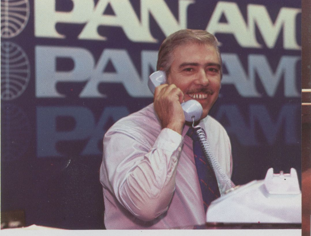 1983, January, A Passenger Service Agent speaking on the phone at  Pan Am's Miami ticket counter.