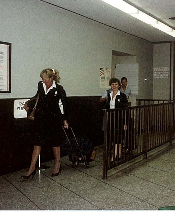 1984 September 11 Pan Am flight attendants exits an aircraft into the terminal , location not known.