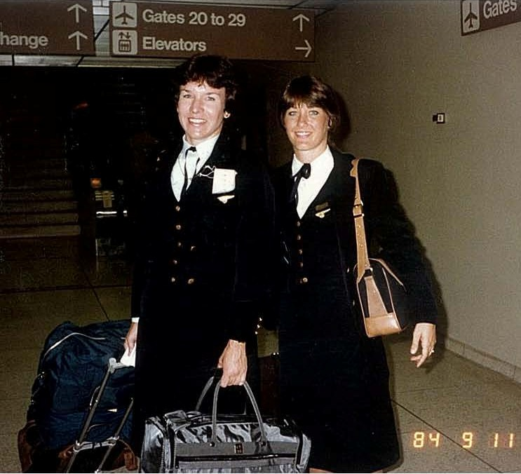1984 September 11, Two Pan Am flight attendants pose for a photo while in transit at an airport, location unknown.