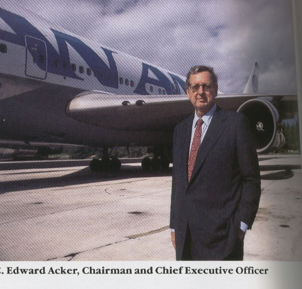 1985, Pan Am Chariman, Ed Acker poses by a 747 in the 'billboard' livery he introduced to Pan Am.