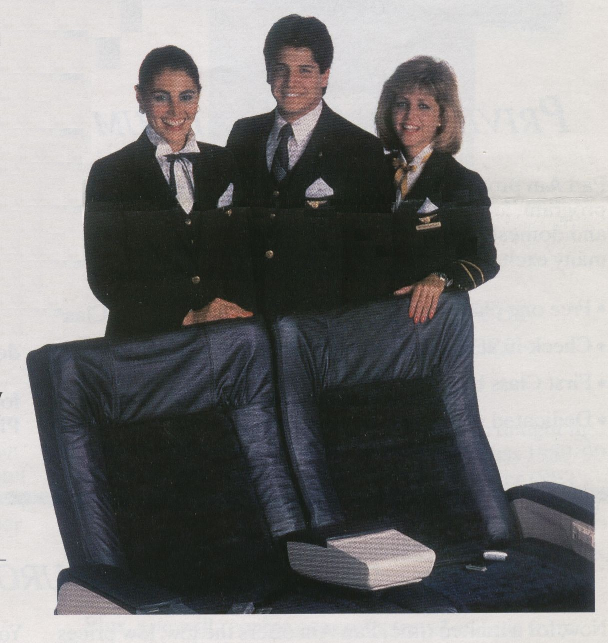 1988 Three Pan Am flight attendants pose by a set of First Class