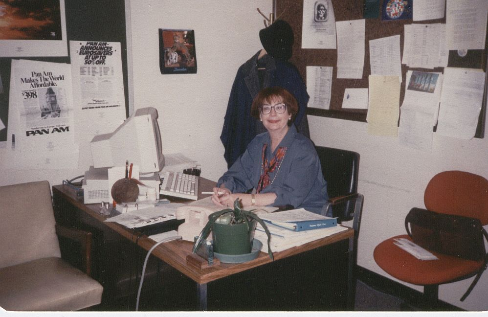 1989, Reservations Supervisor, Helen Harkens, at her desk in the Pan Am Building.  It was Helen's job to ensure all reservations staff were aware of the many different promotions the company initiatied to attract customers.