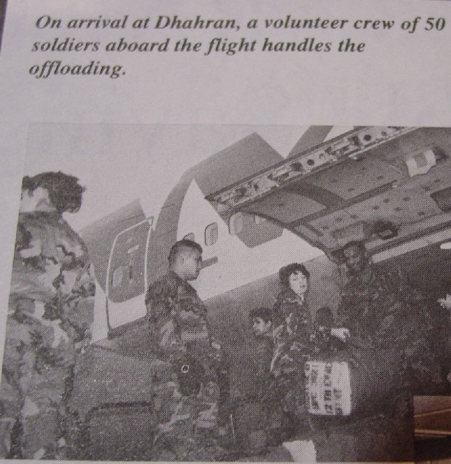 1990, December, A group of  soldiar unload luggage from a 747 in Dhahran, Saudi Arabia as Pan Am delivers another group of soldiars to participate in Operation Desert Storm.