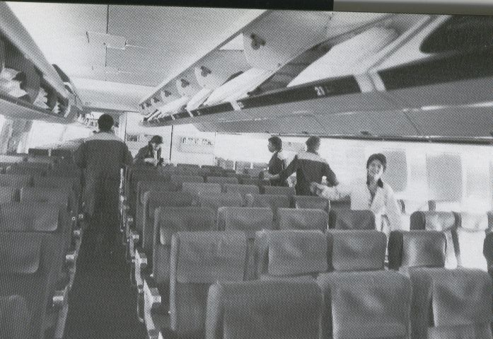 1991 Pan Am 'Fleet Service' staff in Frankfurt clean the economy cabin of a 747 prior to customer boarding.