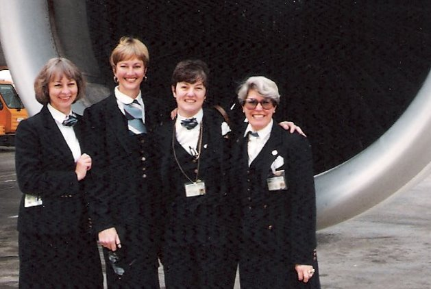 1991, October, From left to right crew members  Judy Donaghy Judy Skartvedt, Jan Pope, Nancy Hite Speck pose in front of the engine of a Pan Am Airbus A310 at the Airport in Rome, Italy.