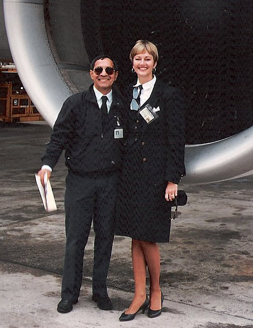 1991,  October, Lead Mechanic & Judy Skartvedt pose for a photo in front of a Pan Am Airbus A310 on the ramp of the airport in Rome, Italy.