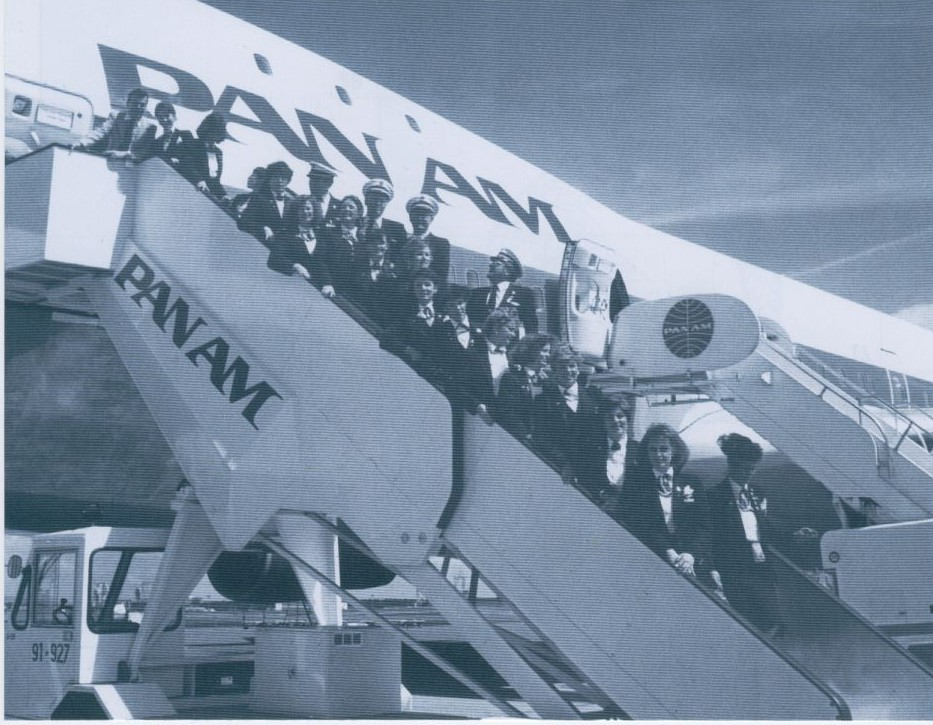 1991 A Pan Am crew assigned to a White House 'Press Charter' flight pose for a picture on the stairs with their 747 in the background.
