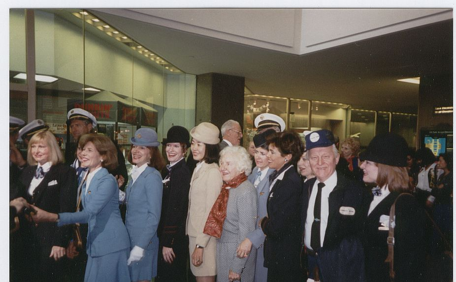 In 1994 a plaque was dedicated to the memory of Pan Am in the lobby of what had been the Pan Am Building and is now the Met Life Building.  Pan Am employees were invited to participate and encouraged to wear old uniforms.  Madeline Cuniff, Pan Am's first female flight attendant can be seen in the red scarf posing with former colleagues at the dedication.