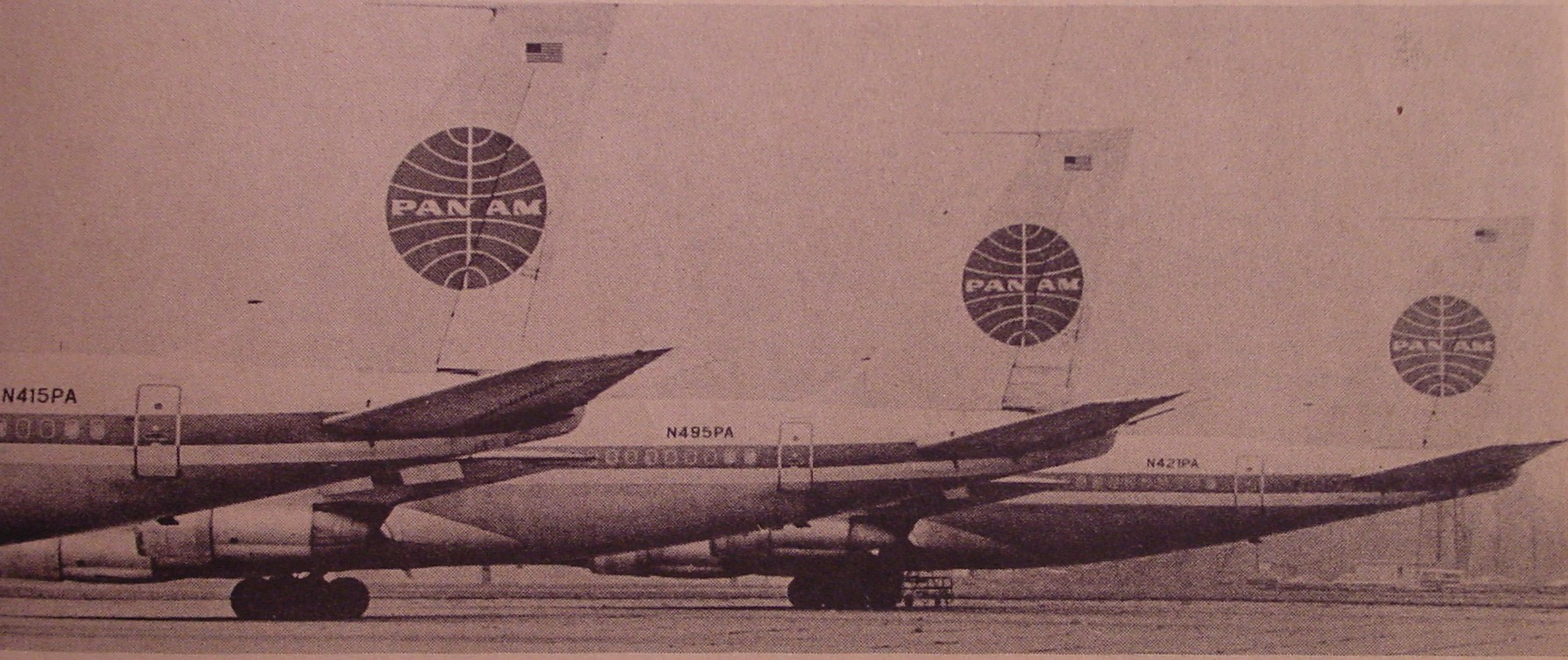 Three Pan Am 707 tails on the ramp in Detroit.