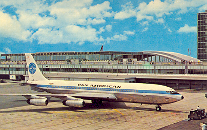 1960s A Pan Am 707 parked in front of the International Arrivals Building at JFK Airport in New York.