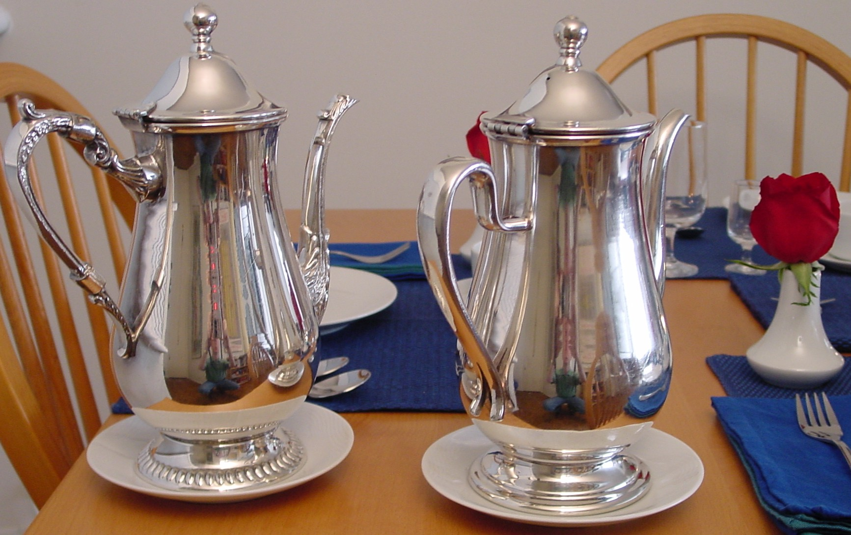 Silver plate coffee pots from the 1980s are shown on the table.