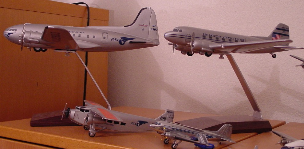 On top the model on the left is a Pan American Boeing 307 Sratoliner.  On the top right is a Pan American Douglass DC3.  Both of these models were produced by Atlantic Models in Florida.  Below left is the Ford Trimotor and on the right another example of the DC3.  The smaller DC 3 was produced by the famous English toy car manufacturer Corgi.