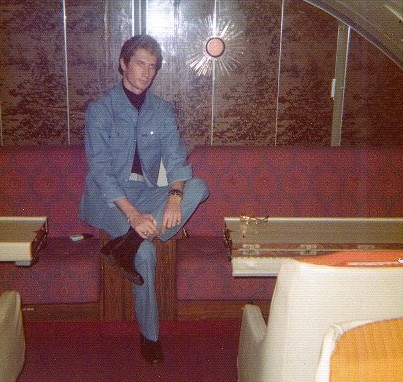 1970s A customer poses in the upper deck dinning room of a Pan Am 747 on a short flight not offering dinning service.