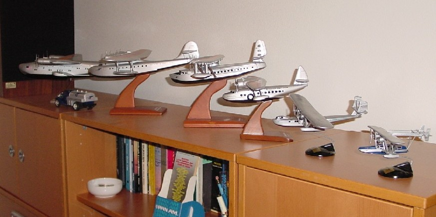 A collection of Pan American flying boat models from largest to smallest.