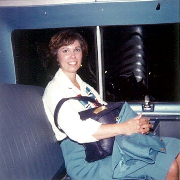 1970s A Pan Am flight attendant waits patiently in the crew van for a soon to come hotel rest