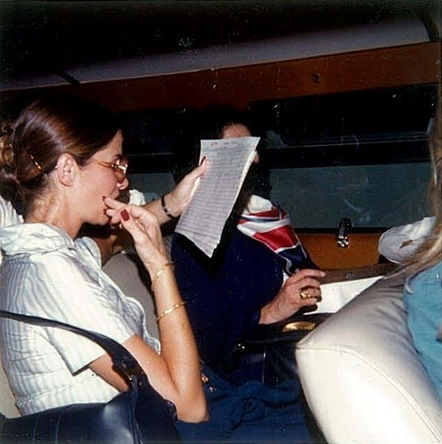 1970s Pan Am flight attendants relax and read in the hotel crew van after arrival on Guam