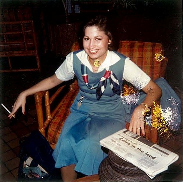 1970s Pan Am flight attendant Sarah McPale relaxes in the lobby of the Guam Hilton prior to crew pick up for flight 842 to Honolulu.