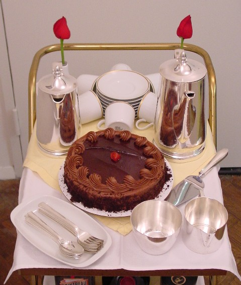 Chocolate cake & coffee are offered from the cart on 1970s Gold Rim china.