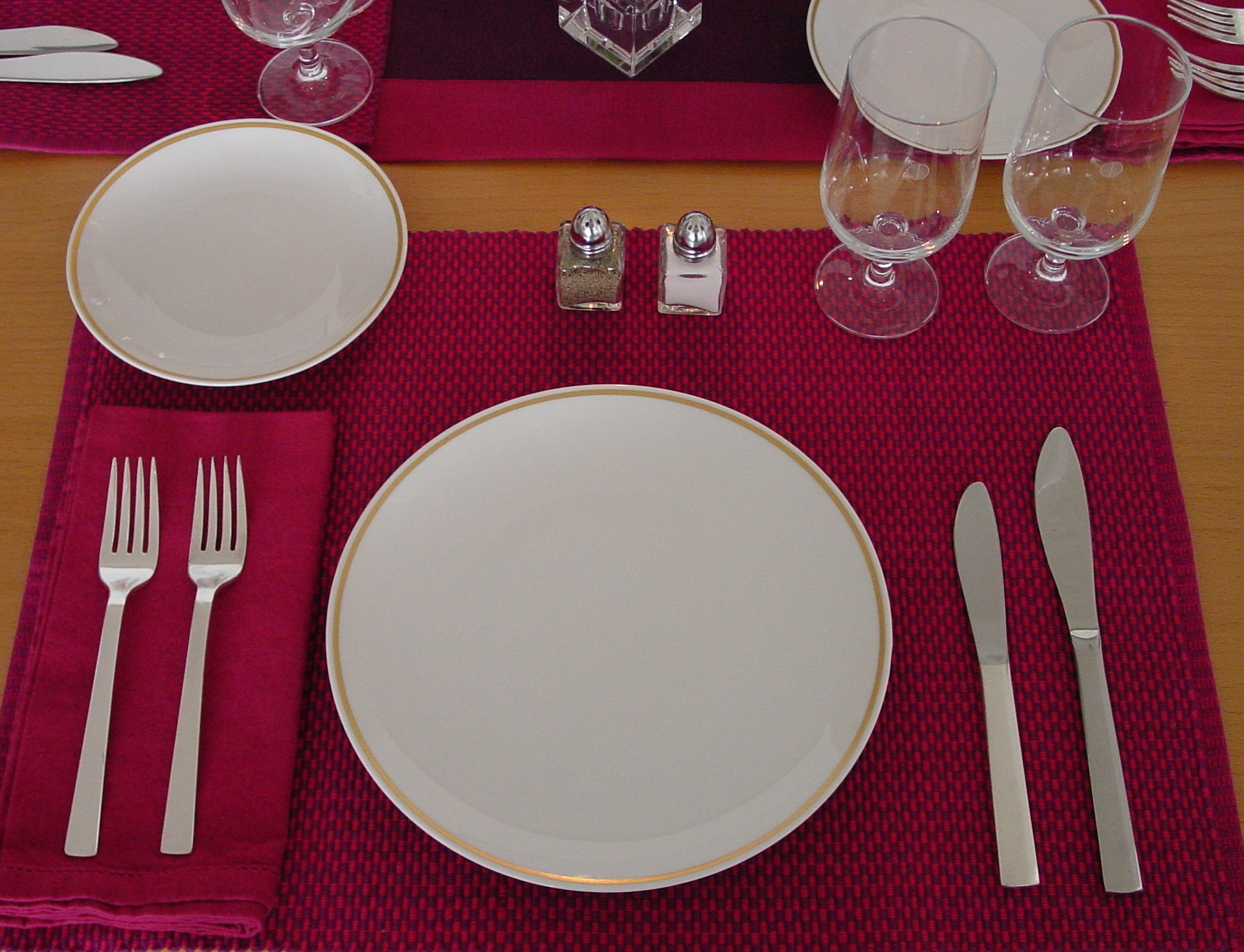 An individual place setting of the 1970s  Pan Am Gold Rim pattern is shown here.