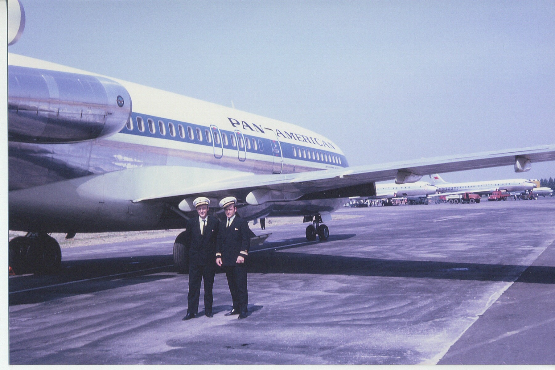 1966, July, Ray LeDour posing by a Pan Am 727-100 aircraft in Moscow.  Ray and the crew were in Moscow as part of an advance team preparing for regular Pan Am service to the Russian City that would start in July of 1968.