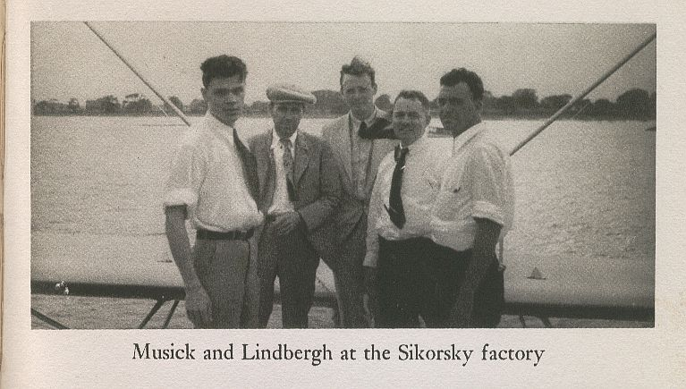 1930s Famed Pan Am pilot Edwin Musick(center wearing hat) and Pan Am consultant Charles Lindbergh(center with tie blowing) at the Sikorsky factory in Connecticut