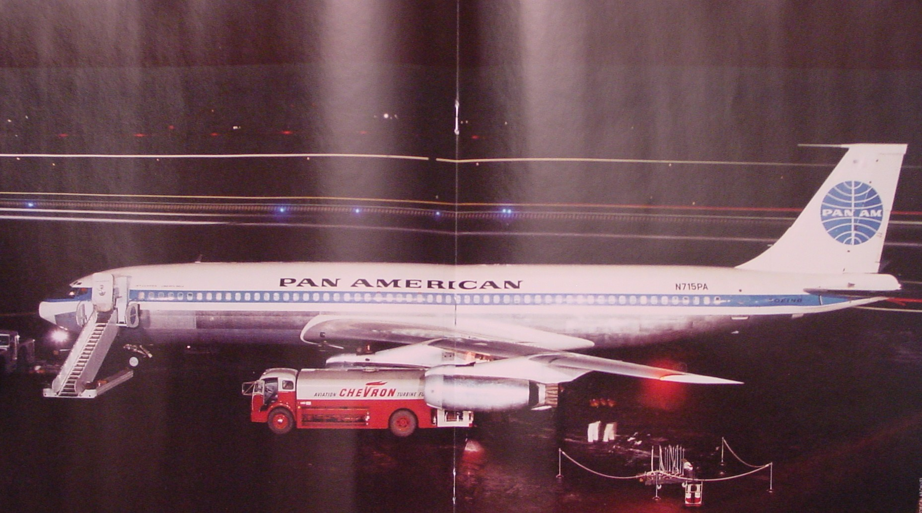 A night shot of Pan Am Boeing 707 tail number N715PA Clipper Liberty Bell.