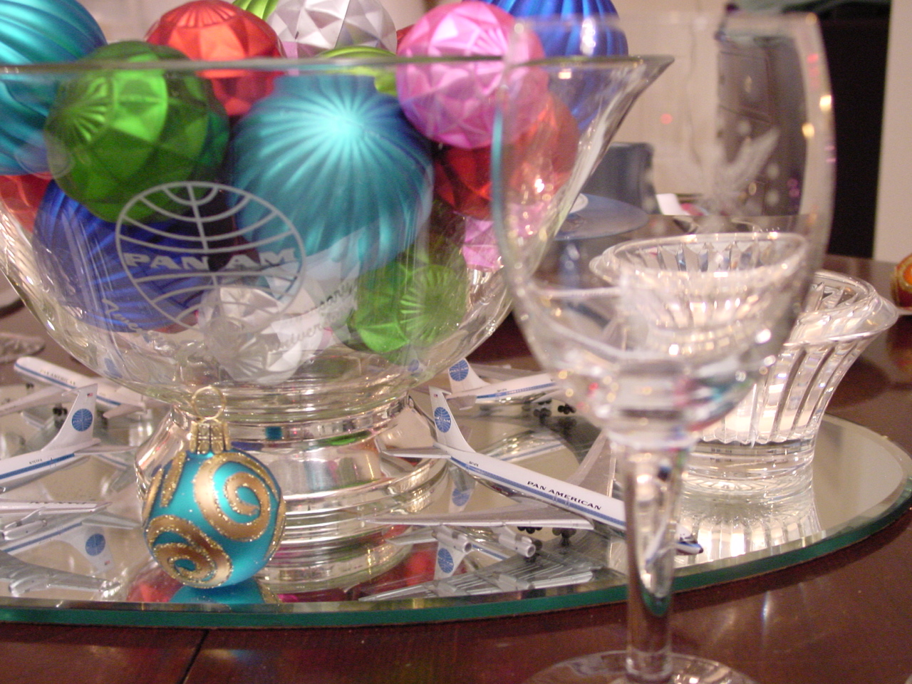 Mini models and glass balls are used as a center piece with a 1960s 'President' pattern setting.