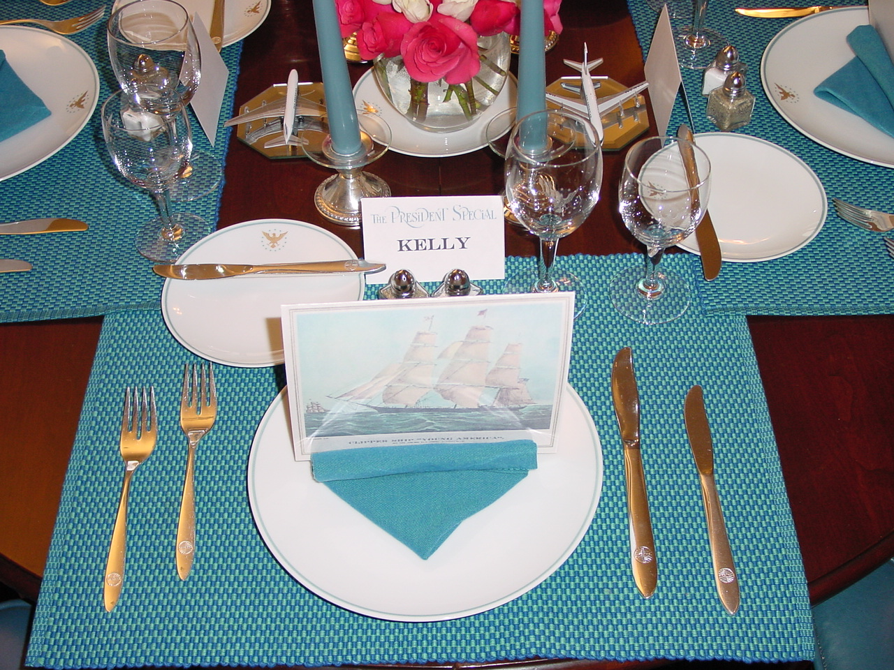 Reproduced 1960s menus with the meal of the evening printed inside lend a bit of authenticity to the 1960s Pan Am 'President' table setting.