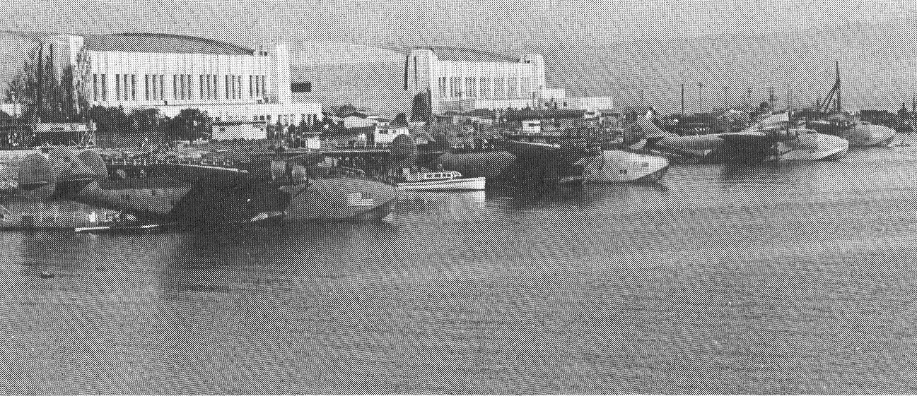 1944 July Four Boeing B314s in camoflage markings  moored Treasure Island, San Francisco, California