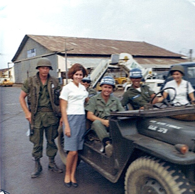 1960s Venice poses with Armed Service members during a transit of Saigon.  Her arcraft is about to depart with a load of soldiers heading for Rest & Recuperation away from Vietnam.  Pan Am flew hundreds of these flights during the Vietnam conflict.  They were operated at cost and not for profit..