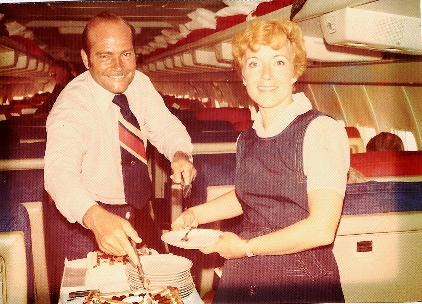 1970s Ray  & Andree LeDour working the dessert cart on a Pan Am Boeing 707 all first class charter for Olsen Tours.
