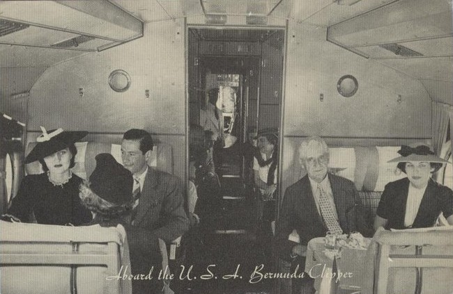 1930s The passenger cabin of a Pan Am Sikorsky S-42 flying boat.  Note the flight steward in the aisle.