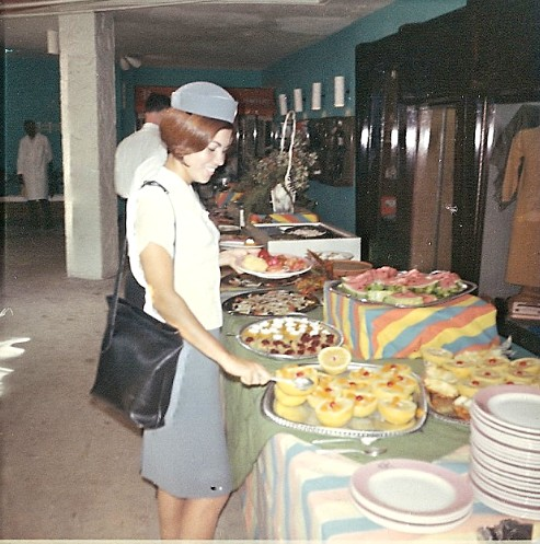 1967 Venice Fernandez enjoys a hotel buffet lunch during a multi-hour transit on St. Croix.