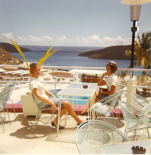1967 Bernadette Degroote, left,  and  Venice Fernandez, right, enjoys a hotel buffet lunch pool side during a multi-hour transit on St. Croix