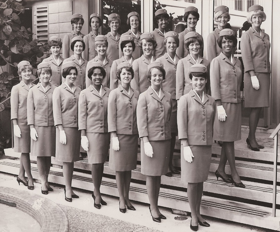1967, June, Class photo on the steps of the Pan Am training facility Miami.  Venice Fernandez , front row, third from left.  Forth from left is Beverly Holness.  Olive Perry is in the middle row, first on right.  Joan Crawford is in the top row, forth from right .  These four women were all hired by Pan Am in Jamaica.  Friend & roomate, Bernadette Degroote is also in the top row, third from left.