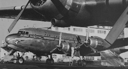 A Pan Am DC 4 on the ramp.