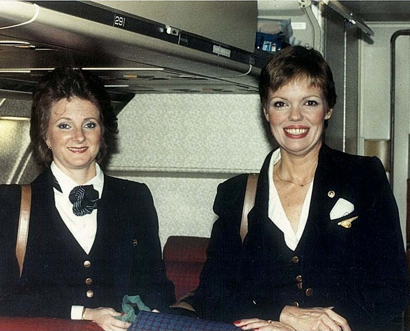1980s Two Pan Am flight attendants pose for a picture in the rear of a Boeing 727-200.