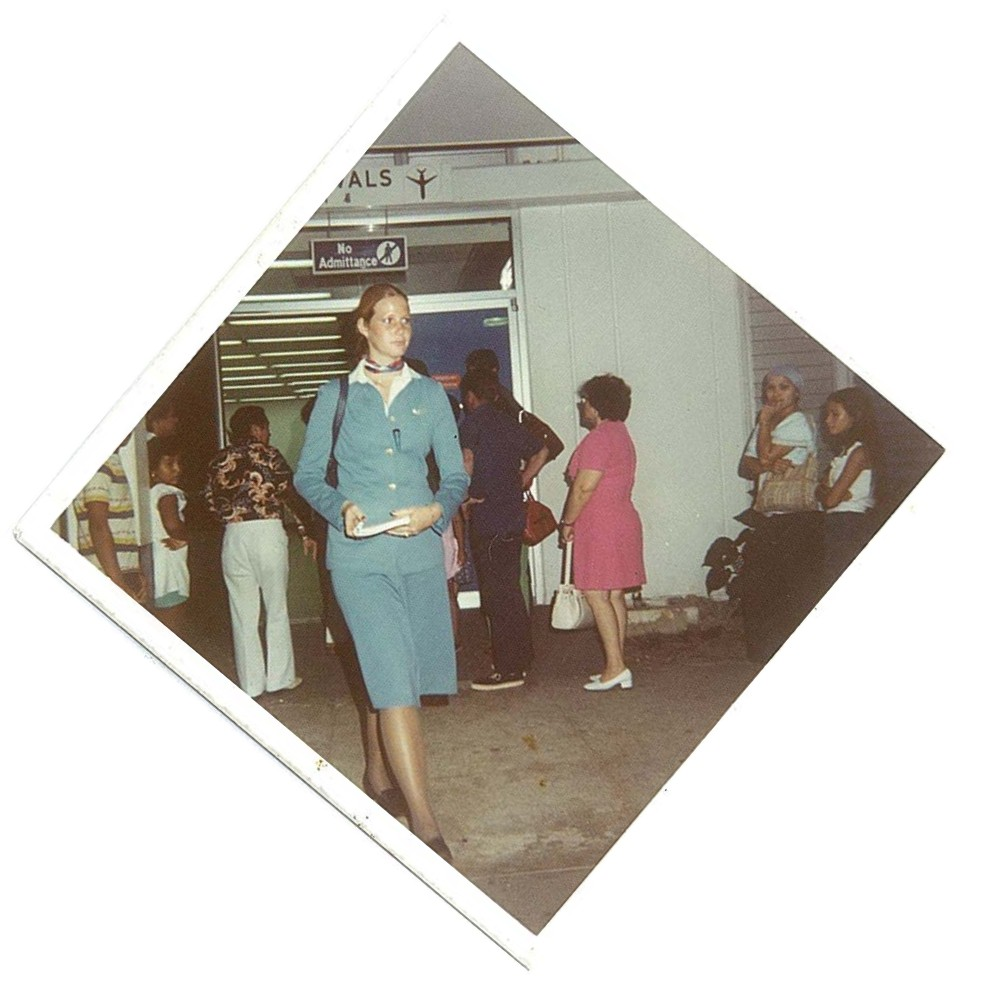 1970s Pan Am flight attendant exiting the Guam Immigration Hall and heading towards the crew van.