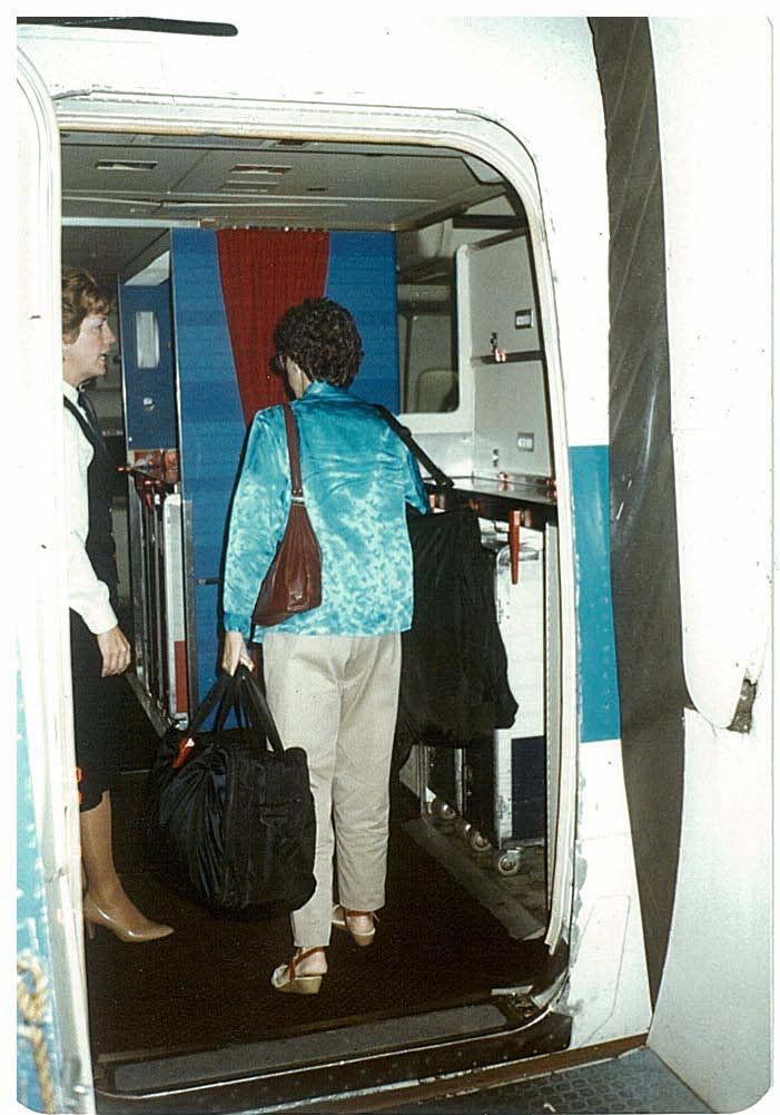 1980s Passenger boarding a Pan Am 747 at the second door on the left side of the aircraft in Los Angeles.