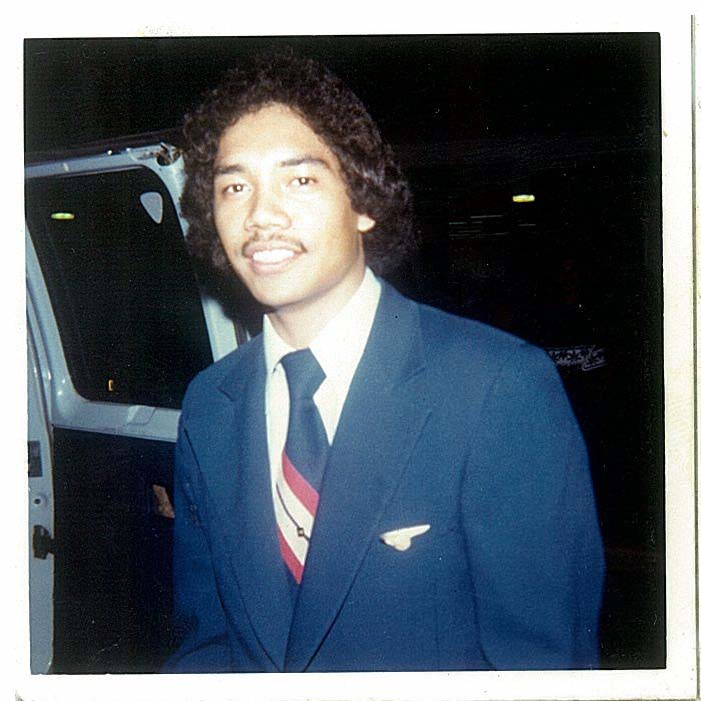 1970s A Pan Am flight attendant posing by the crew hotel van outside the Guam airport terminal