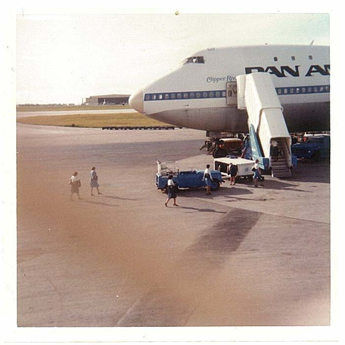 1970s Pan Am crew members prepare to board Boeing 747 tail number N740PA Clipper Rival in Guam during a crew change transit of flight 841 enroute from Honolulu to Manila and Hong Kong.