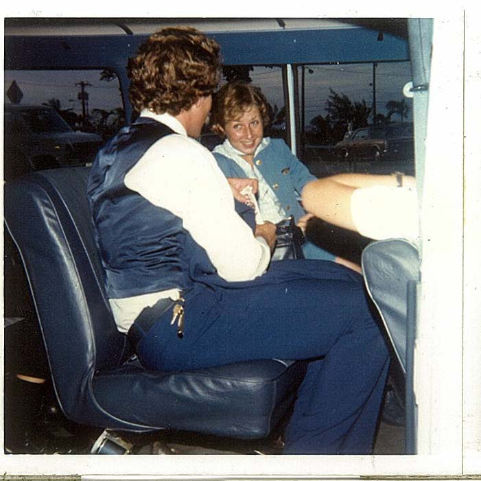 1970s Pan Am flight attendants relax and talk in the hotel crew van after arrival on Guam.